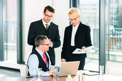 Business - meeting in office, people working with document. Business - meeting in office, the businesspeople with boss and team are discussing a document on royalty free stock image