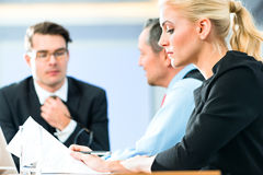 Business - meeting in office, people working with document. Business - meeting in office, the businesspeople with boss and team are discussing a document on royalty free stock photography
