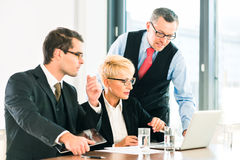 Business - meeting in office, people working with document. Business - meeting in office, businesspeople are discussing documents on Laptop and tablet computer royalty free stock photos