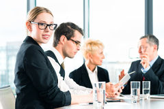Business - meeting in office, people working with document. Business - meeting in office, the businesspeople or lawyers in team are discussing a document on royalty free stock photos