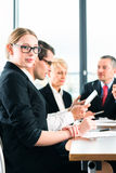 Business - meeting in office, people working with document. Business - meeting in office, the businesspeople or lawyers in team are discussing a document on royalty free stock image