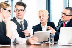 Business - meeting in office, team working with tablet Royalty Free Stock Photography