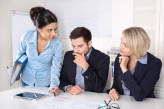 Business meeting at office with three business people. Royalty Free Stock Photos