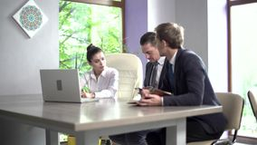 Business Meeting of Business Partners of Managers of Large IT Companies. Two Business Men and a Business Woman Negotiate a Partnership. They Sit in a Meeting stock video
