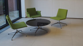 Business meeting room three green chairs and round table Royalty Free Stock Photo