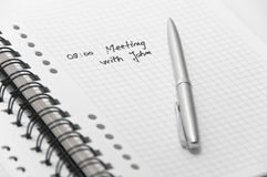 Business meeting scheduled on notebook Royalty Free Stock Images
