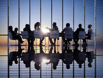 Business Meeting. Silhouette with sunset stock images