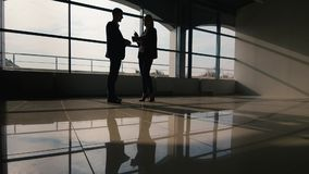 Business meeting, silhouettes of men and women. Business meeting, silhouette of men and women who discuss business matters stock footage