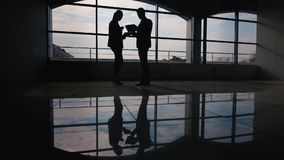 Business meeting, silhouettes of men and women stock footage