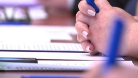 Business meeting, table discussions, teamworkBusiness meeting at the table, people holding pens, glasses, notebooks. Business meeting, table discussions stock video footage