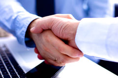 Business meeting at the table shaking hands Royalty Free Stock Photo