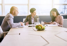Business meeting between three professional partners early in the morning royalty free stock image