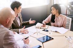 Business meeting between three professional partners early in the morning royalty free stock images