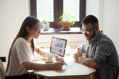 Business meeting: two millennial coworkers solving working quest royalty free stock images