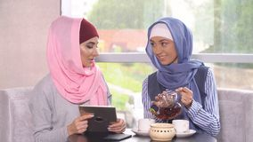 Business meeting of two Muslim women. Business women in hijabs. Stock Photography
