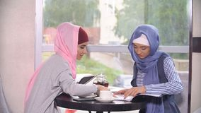 Business meeting of two Muslim women. Business women in hijabs. Business meeting of two Muslim women. Business women in hijabs Royalty Free Stock Images