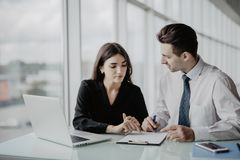 Business meeting. Two professionals signing contract. Office work. Business meeting. Two professionals signing contract in office stock images