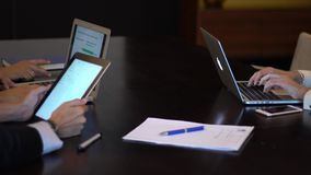 A business meeting using a tablet. A business meeting using a tablet, a man and woman business stock video