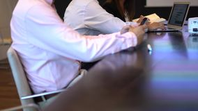 A business meeting using a tablet with stats. A man and woman business stock video footage