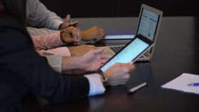 A business meeting using a tablet with stats. A man and woman business stock footage