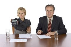Business meeting - woman displays calculator Royalty Free Stock Images