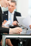 Business meeting with work on contract Stock Photography