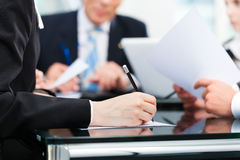 Business meeting with work on contract. Business - meeting in an office, lawyers or attorneys discussing a document or contract agreement stock photos