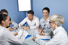 Business meeting with working people. Working persons having a meeting conversation and they sitting around a table on blue background,check also Business people Stock Photography