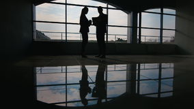 Business meeting of young colleagues. After shaking hands, they communicate with the background of a large window stock video footage