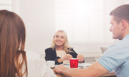 Business meeting. Young hipster businesswoman in modern office royalty free stock images