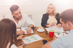 Business meeting. Young hipsters businessmen and women at modern. Business meeting. Young happy businessmen and women at modern office, team corporate discussion Stock Image