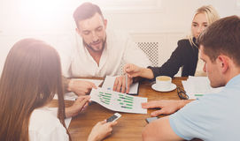 Business meeting. Young hipsters businessmen and women at modern. Business meeting. Young happy businessmen and women at modern office, team corporate discussion Royalty Free Stock Images