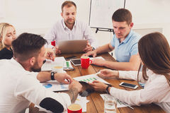 Business meeting. Young hipsters businessmen and women at modern office. Business meeting. Young active businessmen and women at modern office, team corporate Royalty Free Stock Photography