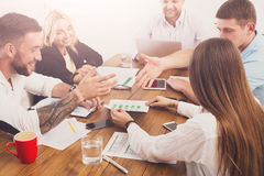 Business meeting. Young hipsters businessmen and women at modern office. Business meeting. Young happy businessmen and women at modern office, team corporate Royalty Free Stock Photography