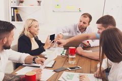 Business meeting. Young hipsters businessmen and women at modern office Stock Photography