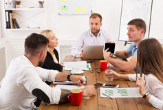 Business meeting. Young hipsters businessmen and women at modern office. Business meeting. Young happy businessmen and women at modern office, team corporate Royalty Free Stock Images
