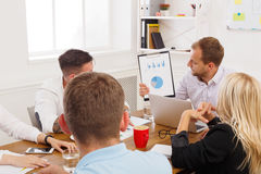 Business meeting. Young hipsters businessmen and women at modern office. Business meeting. Young happy businessmen and women at modern office, team corporate Stock Images