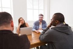 Business meeting. Young team in modern office. Business corporate meeting of multiethnic team. Office discussion, communication with partners royalty free stock photos