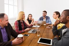 Business meeting. Young team in modern office. Business corporate meeting of multiethnic team. Office discussion, communication with partners, copy space royalty free stock images