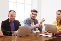 Business meeting. Young team in modern office. Business corporate meeting of successful team. Office discussion, communication with partners, copy space royalty free stock image