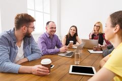 Business meeting. Young team in modern office. Business corporate meeting of successful team. Office discussion, communication with partners, copy space royalty free stock photos