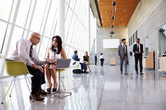 Business Meetings In Busy Office Foyer Area Royalty Free Stock Image