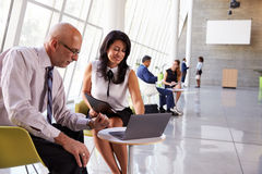 Business Meetings In Busy Office Foyer Area Royalty Free Stock Images