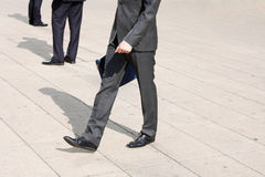 Business men. Walking on the pavement Stock Photo