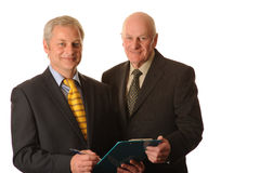 Business men. Two Business men with clipboard Royalty Free Stock Images