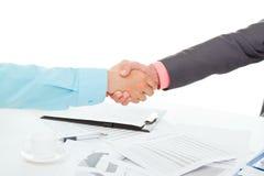 Business men. Business people in elegant suits sitting at desk handshake Royalty Free Stock Photo