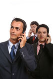 Business men. Three young business men portrait with cellphone on white Stock Image