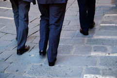 Business men. Three business men walking together down the street Stock Images