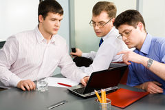 Business men. Team of three business men working together Royalty Free Stock Photos