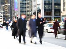 Business Men. This is a blur shot of business people on their lunch hour in Manhattan royalty free stock image